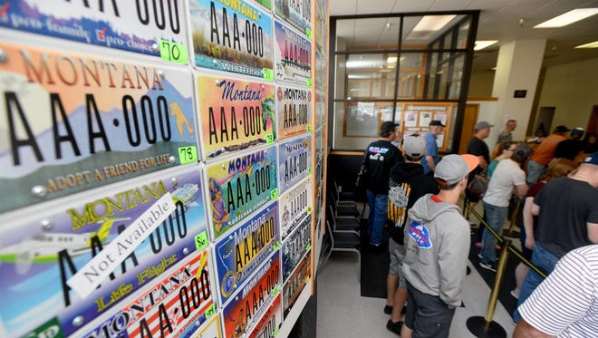 Residents wait in line at the Cascade County Treasurer's Office in this file photo.