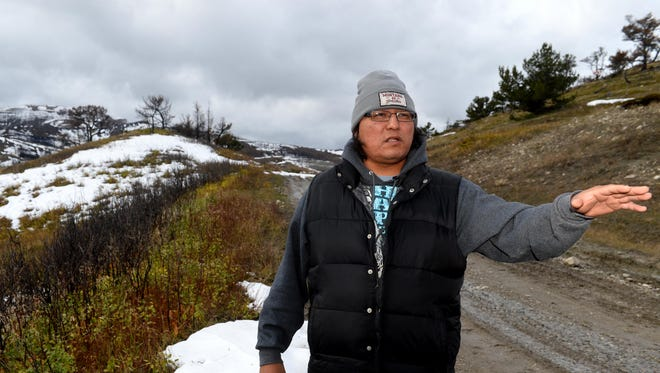 """Clarence Comes At Night talks about the wind-driven Spotted Eagle Fire, which burned 50,000 acres and threatened the town of Heart Butte forcing residents to evacuate in August 2015. """"It doesn't bother me at all,"""" Comes At Night says of the constant wind in Heart Butte."""
