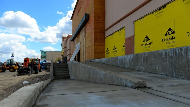 New concrete ramps lead to the entry of PetSmart in the Holiday Village Mall. Construction is underway on the PetSmart and Hobby Lobby stores that are expected to open in June.