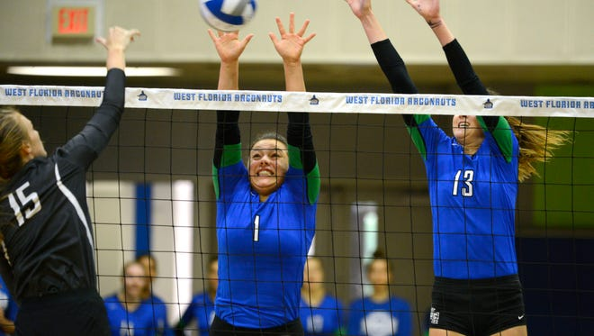 West Florida's Monique StCyr and Rachel Neblett go up for the block Saturday, September 30, 2017 during play against Auburn Montgomery at the UWF Field House.