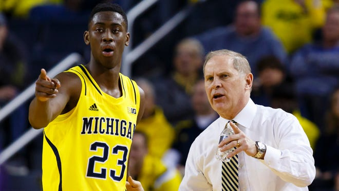 Michigan head coach John Beilein talks to guard Caris LeVert (23) during the first half against the Northwestern Wildcats at Crisler Center.