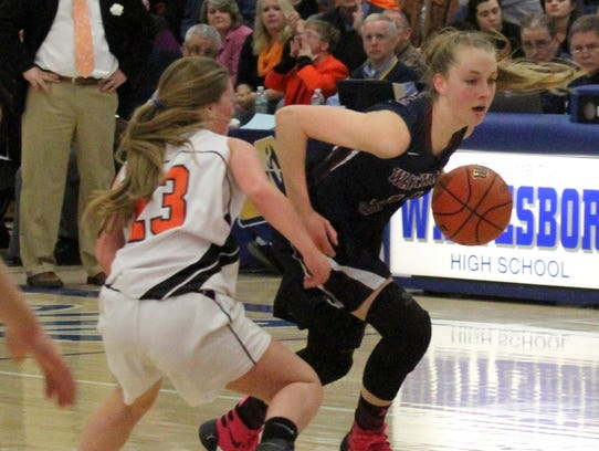 Watkins Glen's Amanda Pike dribbles toward the hoop