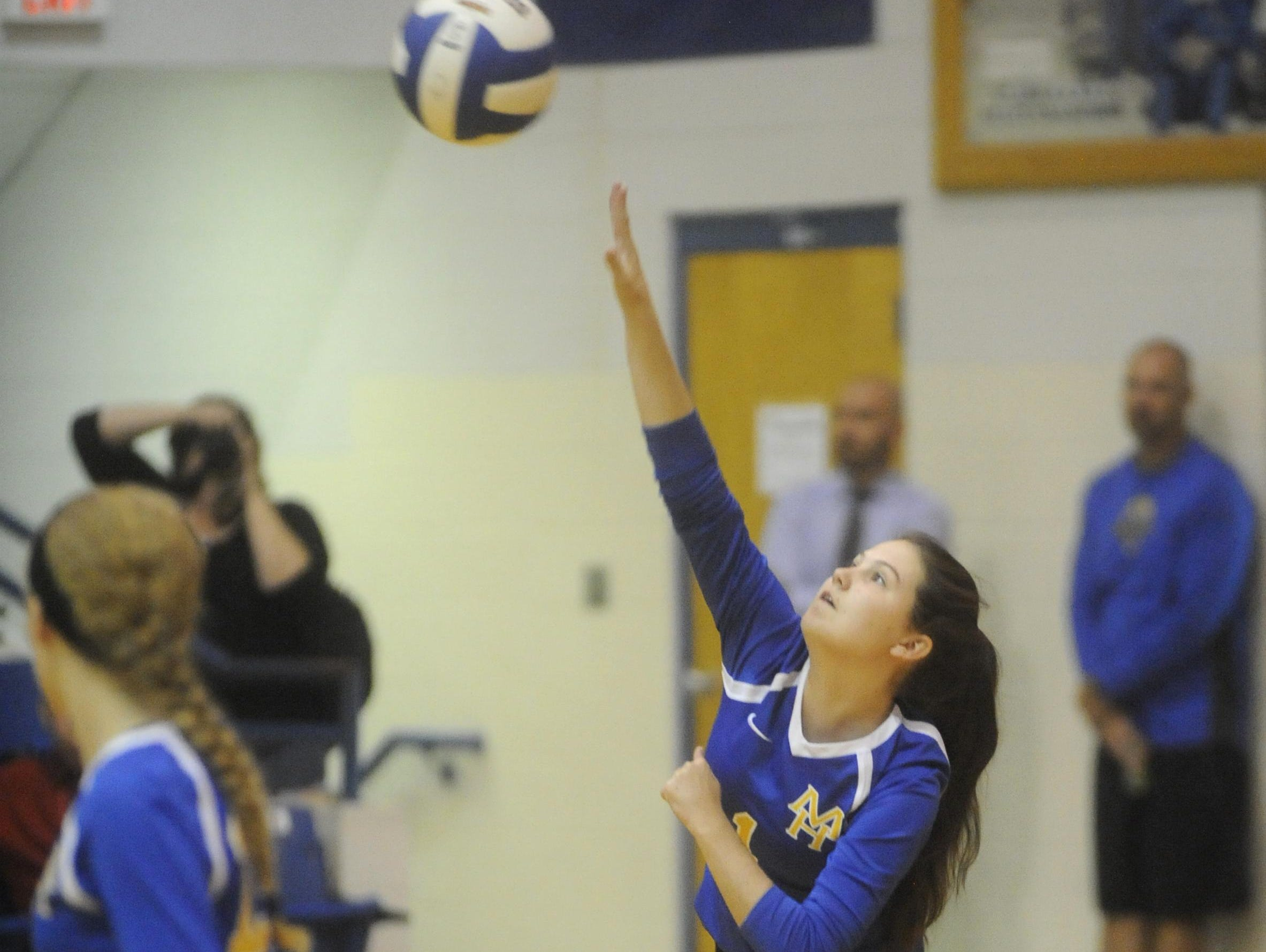 Mountain Home's Ashlyn Paden serves during the Lady Bombers' straight-set victory over Searcy on Thursday night at The Hangar.