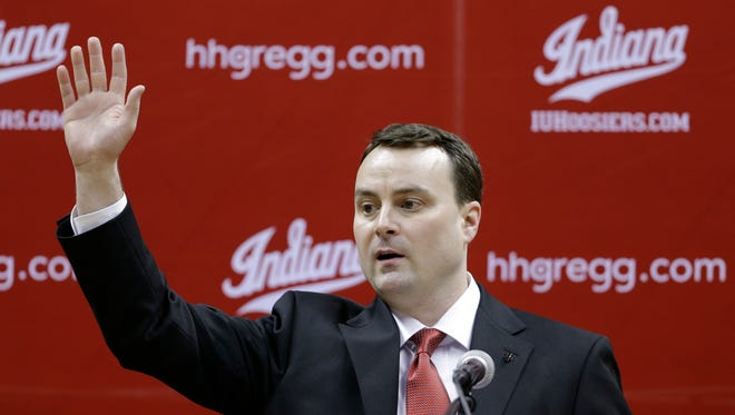 New Indiana coach Archie Miller waves as he's introduced at a news conference on the court in Assembly Hall after he was introduced in Bloomington, March 27, 2017.