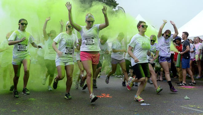 Runners are blasted with green powder as they take off at the start of the Color Vibe 5K run Saturday morning at the W.H. Lyon Fairgrounds. Elisha Page / Argus Leader Runners are blasted with green powder as they take off at the start of the Color Vibe 5K run Saturday morning at the W.H. Lyon Fairgrunds in Sioux Falls, June 15, 2013.  (Elisha Page / Argus Leader)
