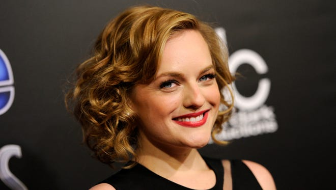 Elisabeth Moss is all smiles as she arrives for the People Magazine awards.