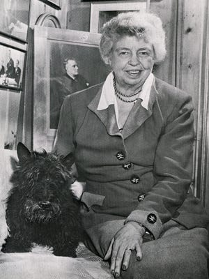 Eleanor Roosevelt poses with Fala, President Franklin D. Roosevelt's Scottish terrier, at Val-Kill in 1951.