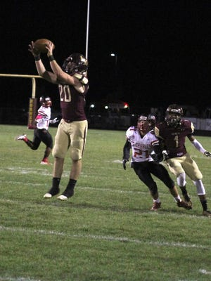 Licking Heights' Cameron Malicoate picks off a pass intended for St. Charles' Jordan Burkey during this past Friday's game. The Hornets won 28-7.