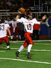 Cardington quarterback Luke McCarrell throws a pass