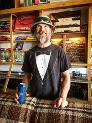 Pete DeBoom stands inside his man cave in downtown