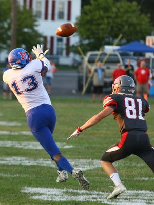 Isaiah Stoneburner from Highland reaches for the ball while defended by Seth Belt of Centerburg earlier this season. The Scots made the playoffs for the first time since 2010.