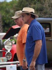 Ed Singer and associate car curator John Giltinan work at last year's car show preview.