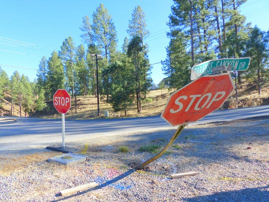 leveled stop sign on Paradise