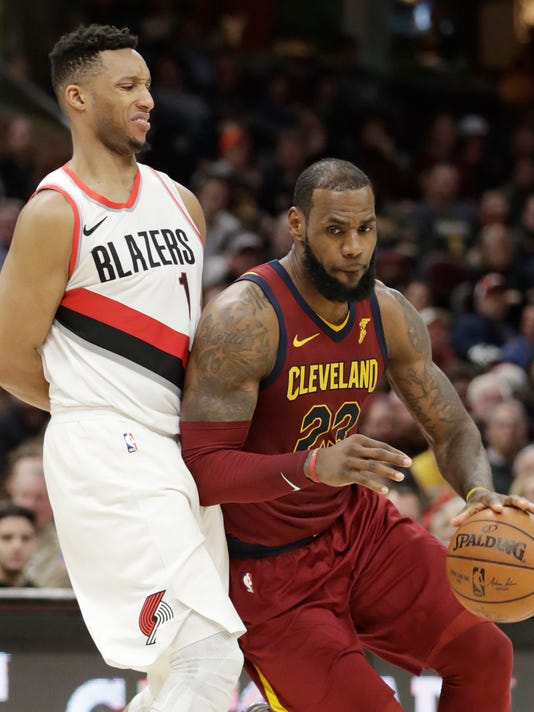 Cleveland Cavaliers' LeBron James (23), drives past Portland Trail Blazers' Evan Turner (1) in the second half of an NBA basketball game, Tuesday, Jan. 2, 2018, in Cleveland. The Cavaliers won 127-110. (AP Photo/Tony Dejak)