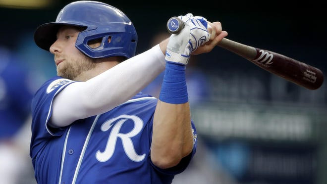 Kansas City Royals' Hunter Dozier bats during the first inning of an exhibition baseball game against the Houston Astros in Kansas City, Monday.