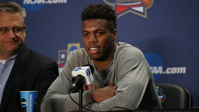Oklahoma Sooners guard Buddy Hield speaks at the Oscar Robertson Trophy player of the year press conference prior to the 2016 Men's Final Four at NRG Stadium.