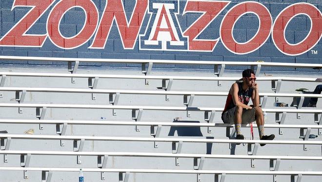 Oct. 15, 2016; Tucson; An Arizona Wildcats fan looks on against the USC Trojans during the second half at Arizona Stadium. The Trojans won 48-14.