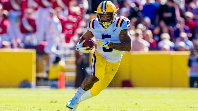 LSU running back Derrius Guice (5) is a load to bring down.