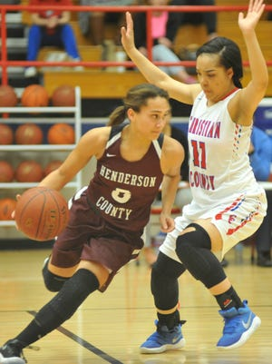 Henderson County's Jaylee Carter dribbles against the defense of Christian County's Laderia Gold during the first half of Thursday's game in Hopkinsville.