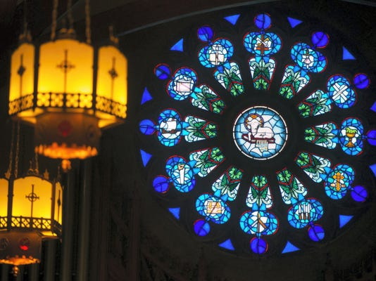 The rose window with a lamb above the altar.