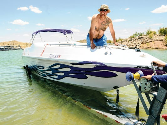 Joe Lopez of El Paso loads his 32-foot boat onto a trailer Monday at Marina Del Sur at Elephant Butte State Park. Lopez said he will be spending Memorial Day at the lake with his family and they already have their campsite picked out.