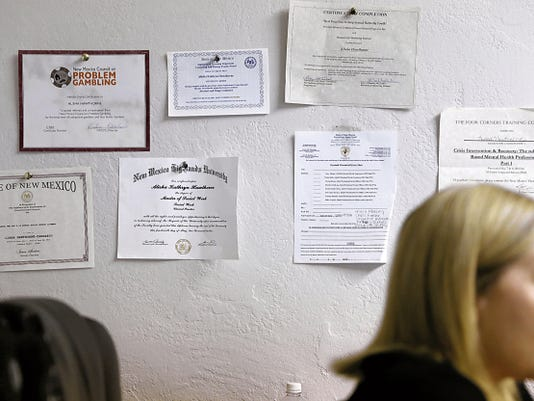 Alisha Hawthorne-Martinez, a therapist at Second Chance Counseling, speaks on Friday at her office, which displays her certifications and degrees.
