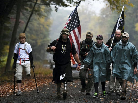 People participate in the third annual March for the Fallen at Fort Indiantown Gap on Saturday, Oct. 11, 2014. Over 470 participants took part in either a 5K, 10K, 16-mile or 28-mile march. Some participants carried a rucksack weighing 35 pounds. The 2015 March for the Fallen is on Saturday.