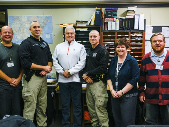 Dane Anthony stands with his staff for one last picture on Thursday, Dec. 31, 2015 in the Franklin County Sheriff Department in Chambersburg, Pa.