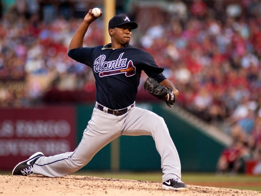 FILE - In this Aug. 24, 2013, file photo, Atlanta Braves pitcher Julio Teheran throws during the fourth inning of a baseball game against the St. Louis Cardinals in St. Louis. Teheran and the Braves and have agreed to terms Friday, Feb. 14, 2014, on a six-year, $32.4 million contract with a club option for the 2020 season. (AP Photo/Sid Hastings, File)