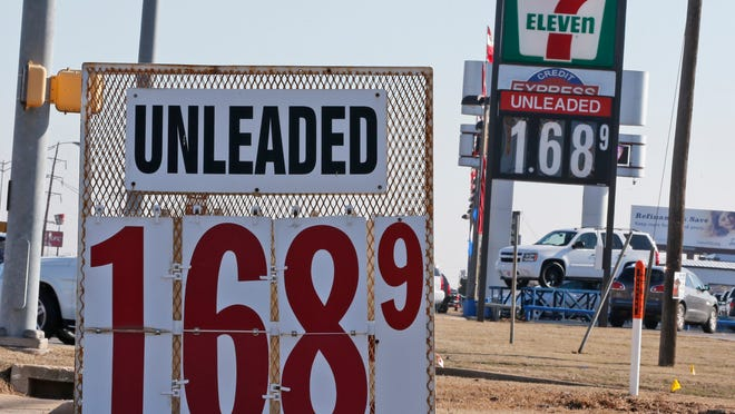 Signs at two gas stations advertise unleaded gasoline for $1.68 Friday in Oklahoma City.