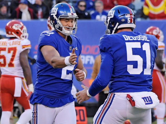 New York Giants kicker Aldrick Rosas (2) celebrates a field goal with teammate Zak DeOssie (51) during the second half of an NFL football game against the Kansas City Chiefs, Sunday, Nov. 19, 2017, in East Rutherford, N.J. (AP Photo/Bill Kostroun)