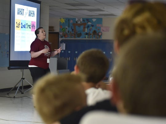 """Camp Invention director Jessica Meacham explains the """"campers showcase'' to visitors Friday, June 16, 2017, on the last day of the camp held at Southern Door. The showcase revealed the inventions created by the students in the week-long camp."""