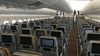 Singapore Airlines' economy cabin is seen on one of the carrier's Airbus A350 widebody jets in Toulouse, France, on Oct. 14, 2016. This particular aircraft was the 10,000th plane to roll off Airbus' assembly lines.