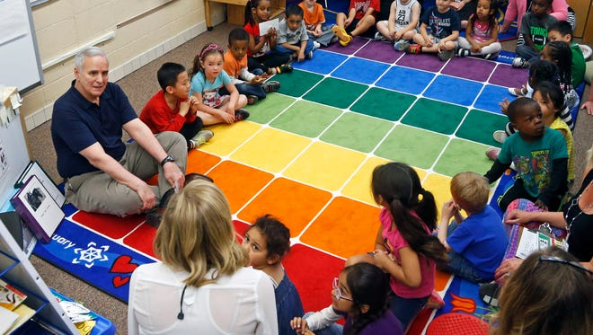 Minnesota Gov. Mark Dayton, left, joins the circle of preschoolers during their class at Westview Elementary School, Friday in Apple Valley. Dayton is pushing to provide preschool for all in the state.