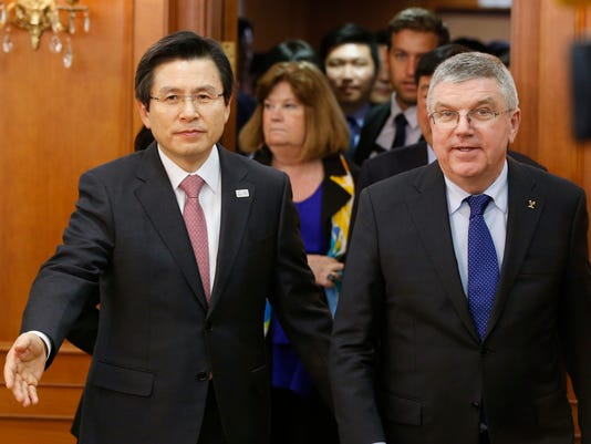 International Olympic Committee (IOC) President Thomas Bach, left, is escorted by South Korea's Prime Minister and acting President Hwang Kyo-ahn for a meeting in Seoul, South Korea, Tuesday, March 14, 2017. (Kim Kyung-Hoon/Pool Photo via AP)
