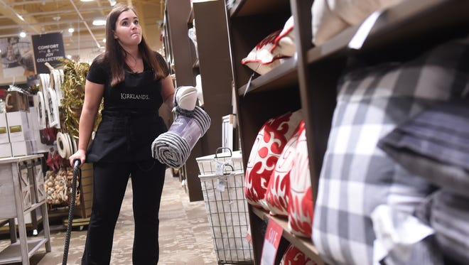 Hannah Mong of Hellam, seen here working one of her three jobs at Kirkland's, is hoping to replace her cane with a service dog. Dealing with a chronic pain issue for the past three years, the full-time Penn State York student has started a GoFundMe page to help raise the $10,000 needed to make this happen.
