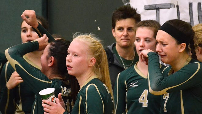 Howell volleyball players react to a 3-1 loss to South Lyon in the Class A district championship game.