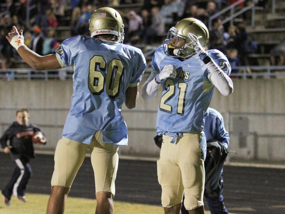 Daniel reciever CJ Scott (21) celebrates with teammate Dylan Perry (60) after scoring a touchdown against Seneca.