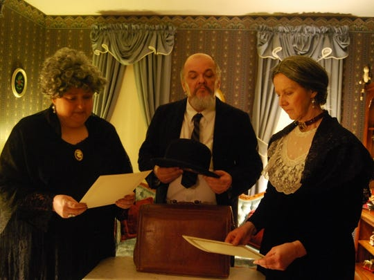 Patti Hann as Abby, Steve Horton as Mr. Witherspoon and Debra Kennedy as Martha look over the commitment papers for Happy Dale Sanitarium.