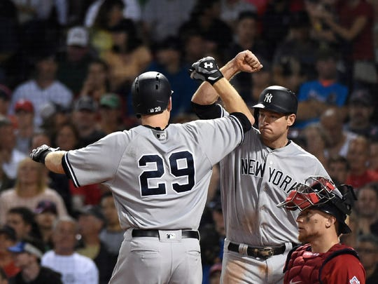 Todd Frazier and Chase Headley celebrate after Frazier's