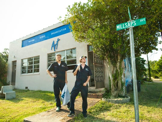 Staff members Daniel Johnson and Travis Pinkston ready for work at the Midtown Debris Organization in 2011.