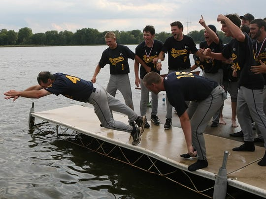 Marquette players go diving into the Wisconsin River