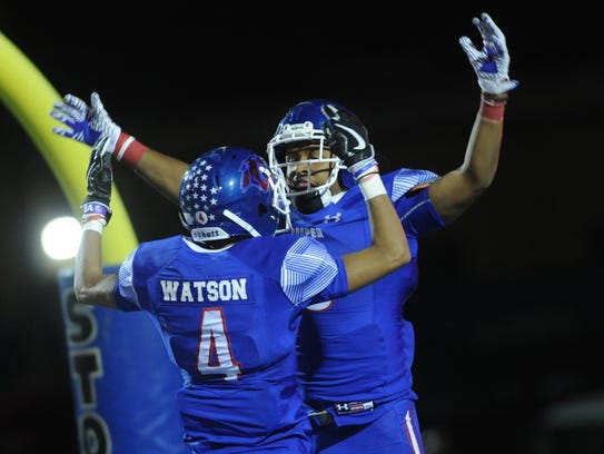 Cooper's Shaun Watson (4) celebrates with Tyrees Whitfield