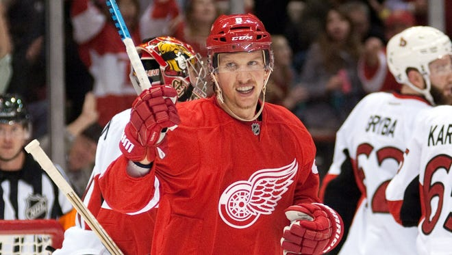 Nov 24, 2014; Detroit Red Wings left wing Justin Abdelkader (8) and left wing Johan Franzen (93) celebrate center Gustav Nyquist (not pictured) goal during the first period against the Ottawa Senators at Joe Louis Arena.