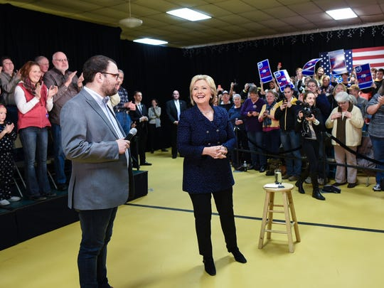 Brooks Brasfield stands with Hillary Clinton at a recent rally in Vinton, Iowa.
