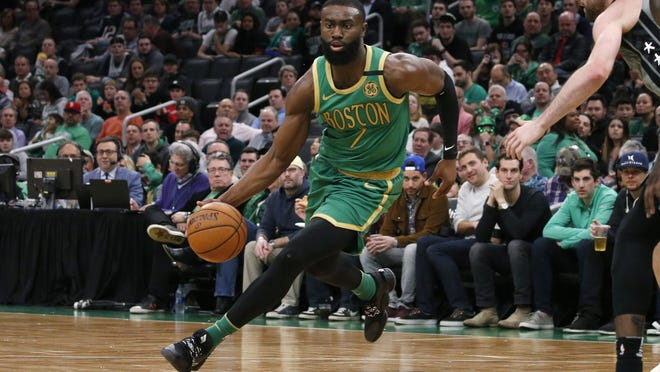 Boston Celtics guard Jaylen Brown (7) drives to the basket against the Brooklyn Nets during the second half of a game, Tuesday, March 3, 2020, in Boston.