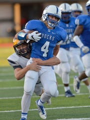 Salem Rock Cody Tapp gains yards until he is bought