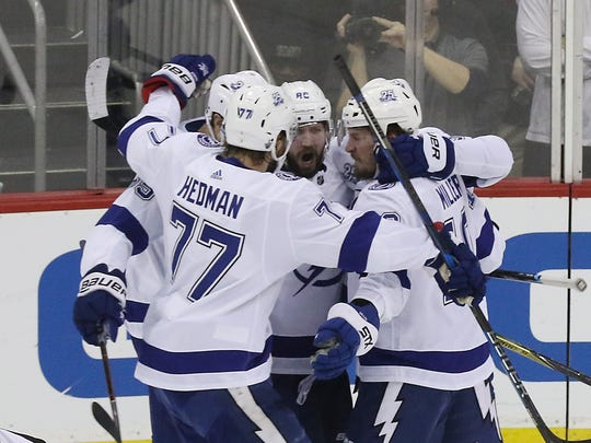 A first-period goal scored by Nikita Kucherov, center, is celebrated by the Lightning, including Victor Hedman (77) and J.T. Miller, who got an assist on the play during Game 4 of the first round Stanley Cup Playoffs on Wednesday, April 18, 2018.