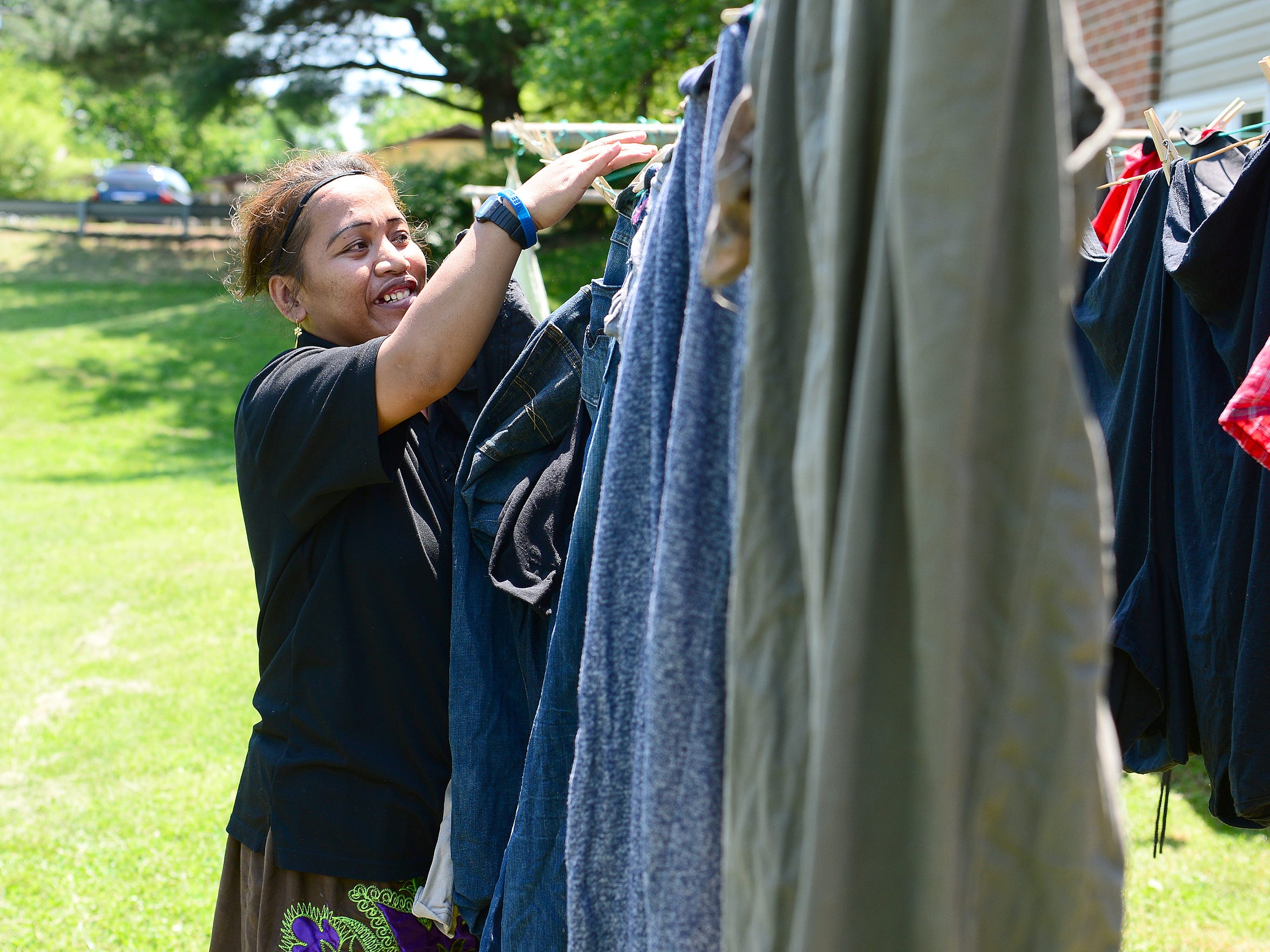 Deaverview resident Elena Jacklick takes her laundry