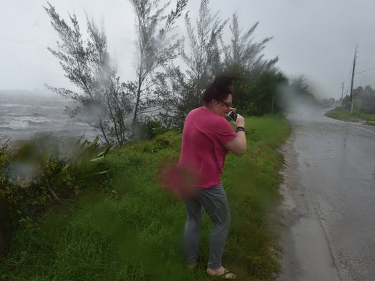 Marlene Rosano, of Port St. Lucie, tries for photos